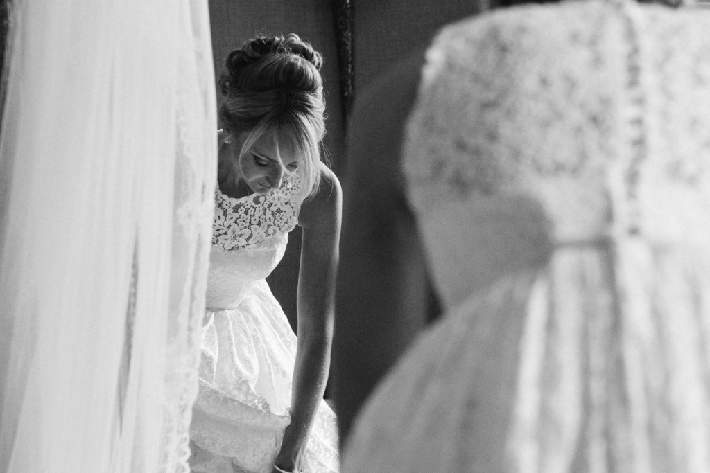 Bridal prep at Carlowrie Castle Scottish castle wedding venue featuring bride wearing a lace Caroline Castligliano wedding gown