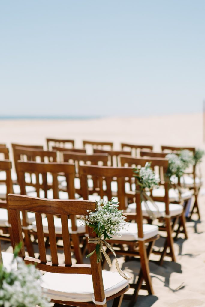 Chair details for a summer beach wedding photo.