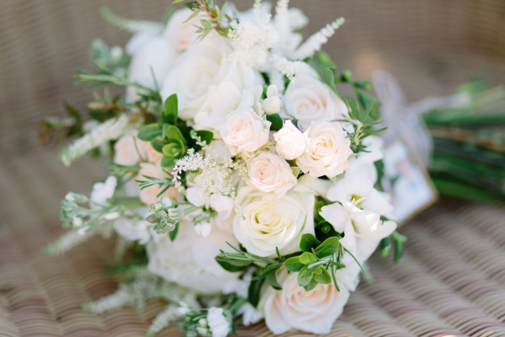 Bouquet featuring peach and white roses for a beach wedding in Portugal by UK Destination Wedding Photographer photo.