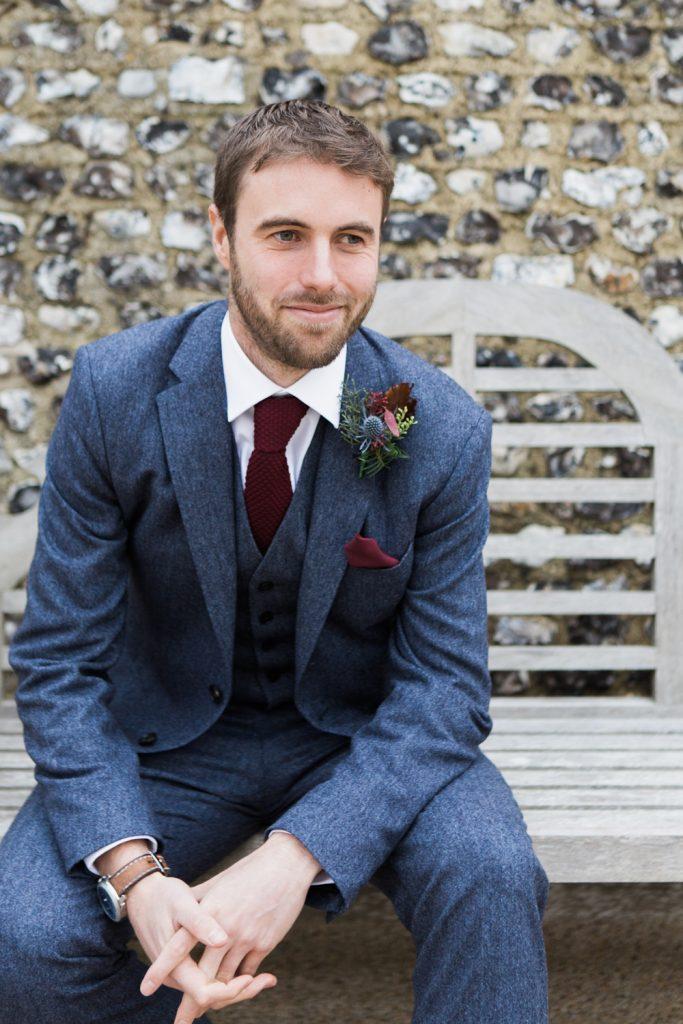 Groom in blue Reiss tweed suit for a winter barn wedding by Cheshire fine art wedding photographer Jade Osborne.