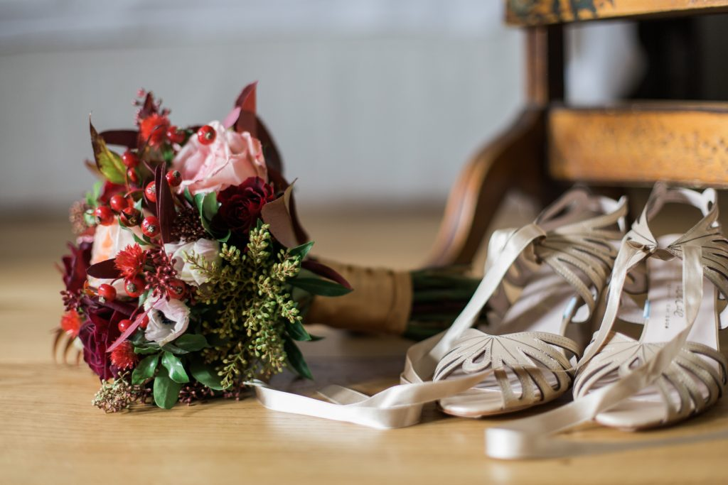 Harriet Wilde gold wedding shoes at Farbridge Barns wedding