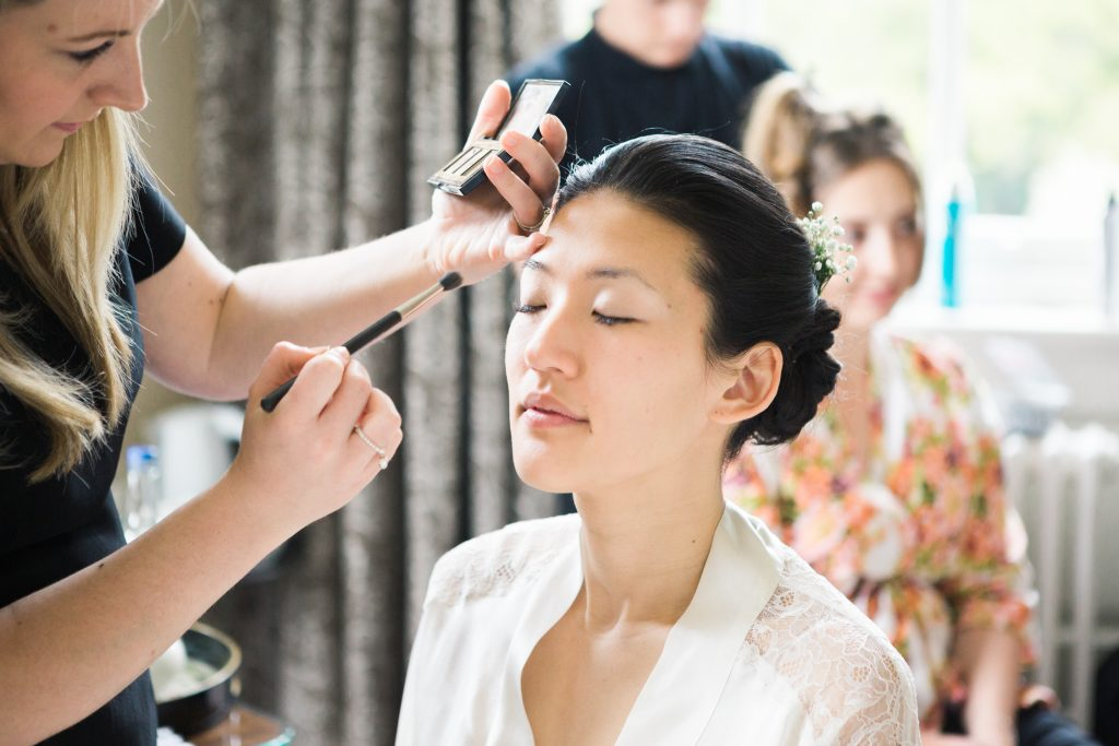 Fine art wedding photography by Cheshire wedding photographer featuring bridal preparations at an elegant spring Iscoyd Park wedding photo