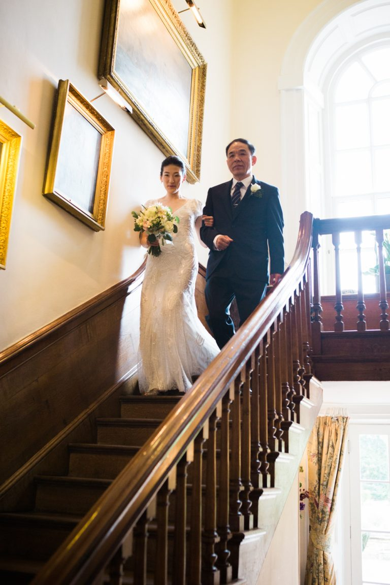 Elegant Spring Iscoyd Park Wedding. The bride wearing Liza Jane Howell wedding dress on the stairs at Iscoyd Park on the way to the ceremony.