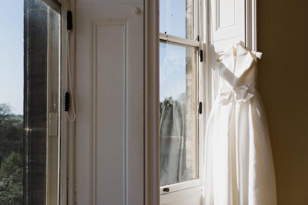 Jesus Peiro wedding dress with large bow for a bridal inspiration shoot at Sandon Hall, Staffordshire - photo