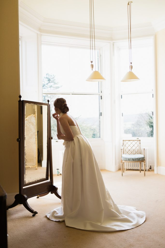 Bridal prep at Sandon Hall, Staffordshire. The bride wearing a Jesus Peiro wedding gown.