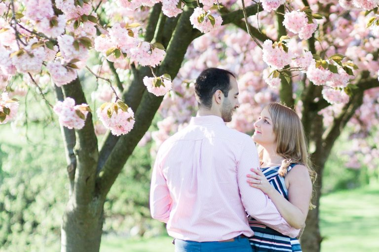 Springtime engagement shoot with tree blossom photo