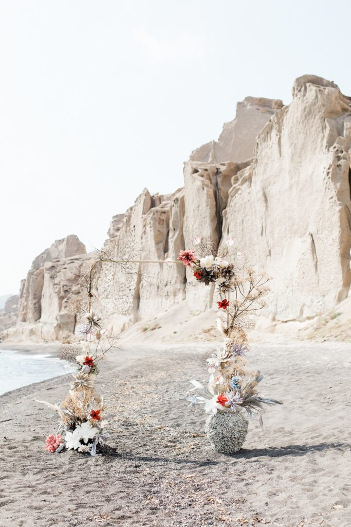 Floral arch on beach at Santorini wedding photo