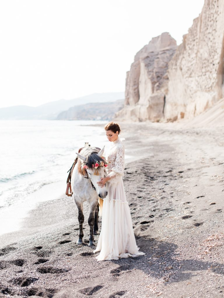 Beach wedding featuring bride in Costarellos wedding dress by UK Fine Art Wedding Photographer