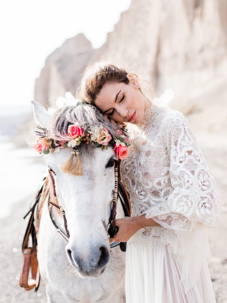 Bridal portrait by Cheshire based wedding photographer featuring beach wedding in Santorini