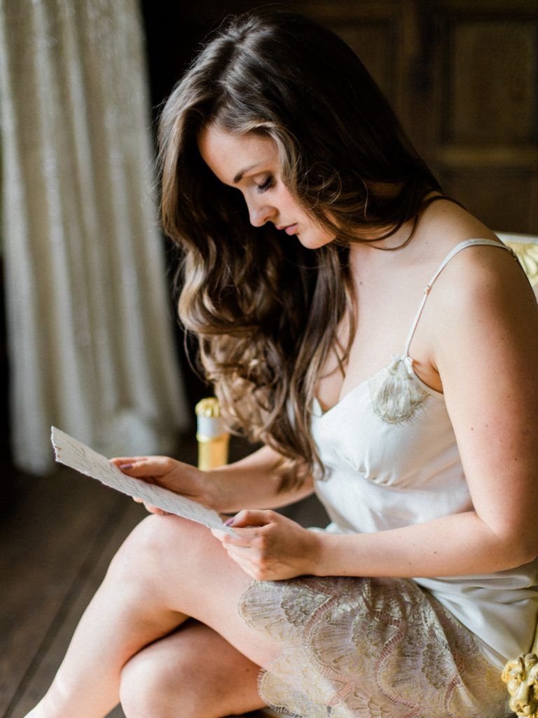 Bridal preparatrion at Dorfold Hall. Bride wearing Shell Belle Couture ivory lace and gold slip.