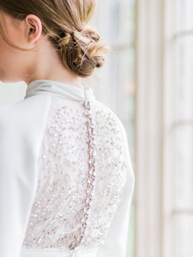 Fine art wedding photographer at Dorfold Hall featuring back detail of Jesus Peiro wedding dress