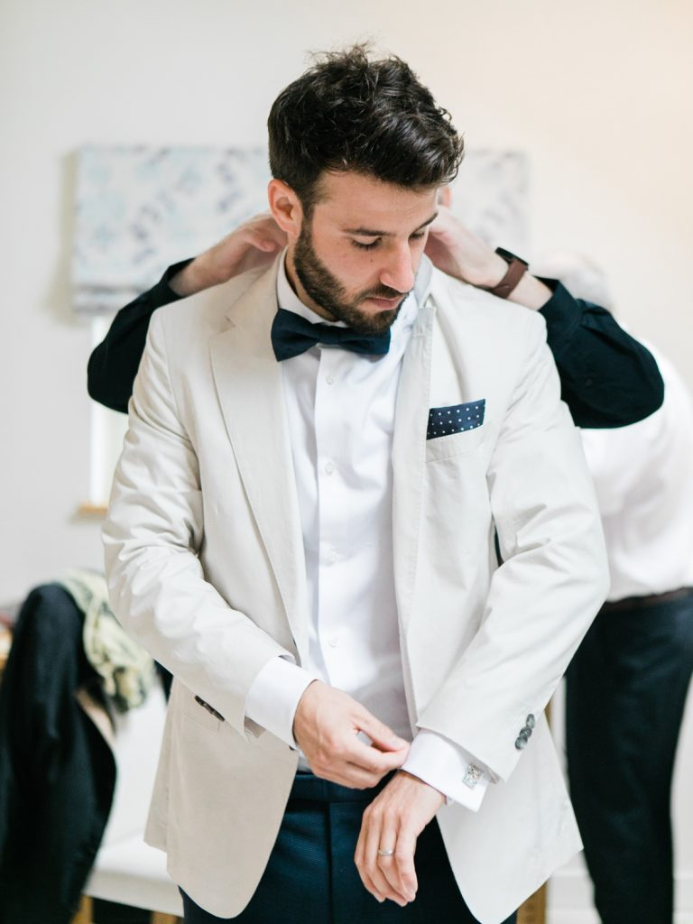 Groom wearing Hugo Boss for a bow tie wedding by Cheshire Wedding Photographer