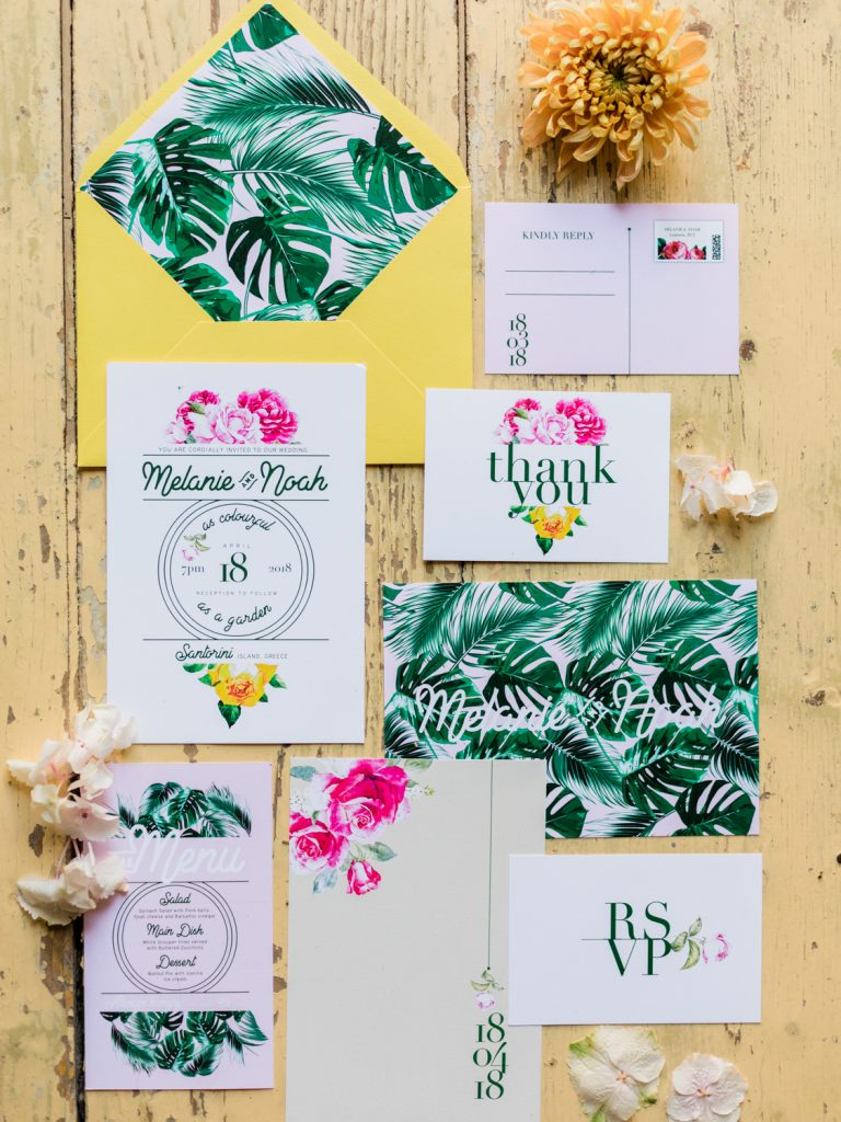 Flat lay stationery suite for a Santorini wedding