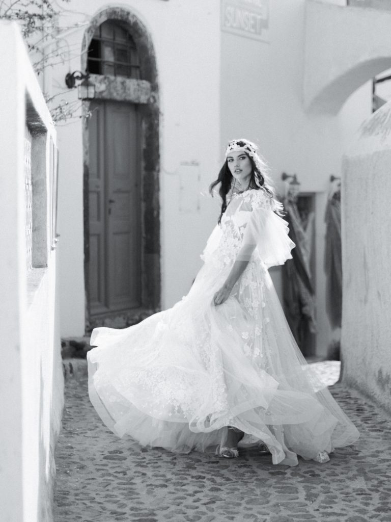 Fine art wedding photography in Santorini, Greece with bride in traditional Greek headdress