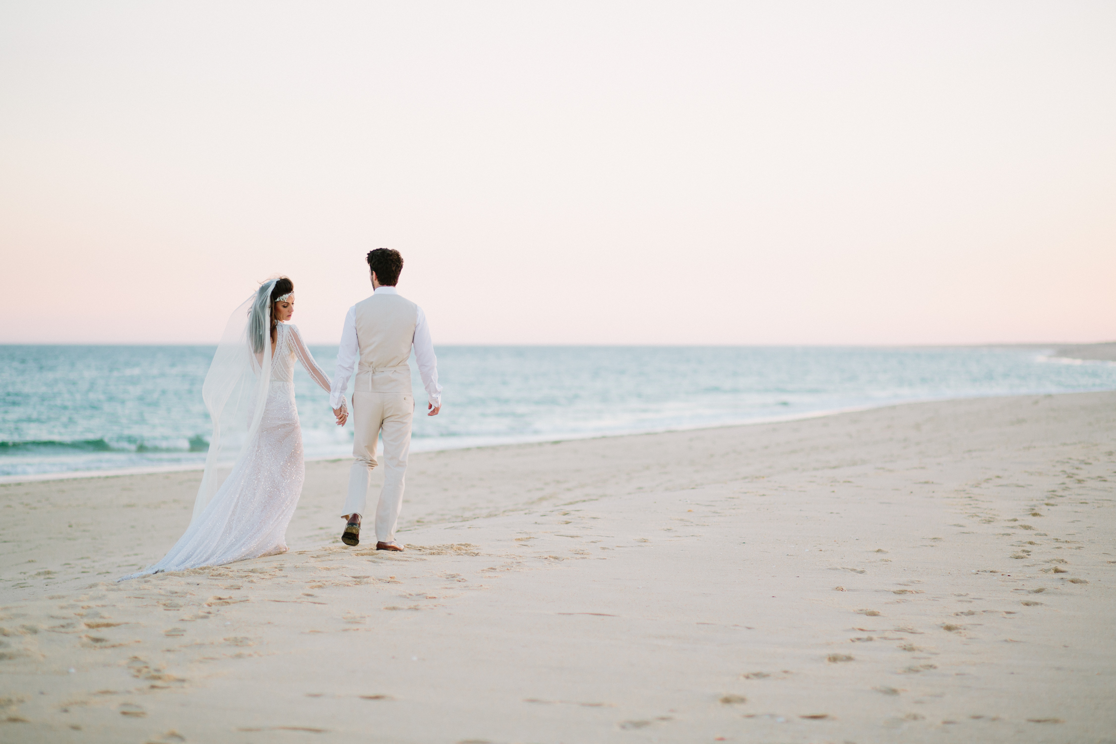 Fine Art Destination Wedding Photographer based in Cheshire in the UK featuring bride and groom portraits on the beach.