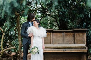Spring wedding at Iscoyd Park featuring bride and groom photos by the piano in the gardens.