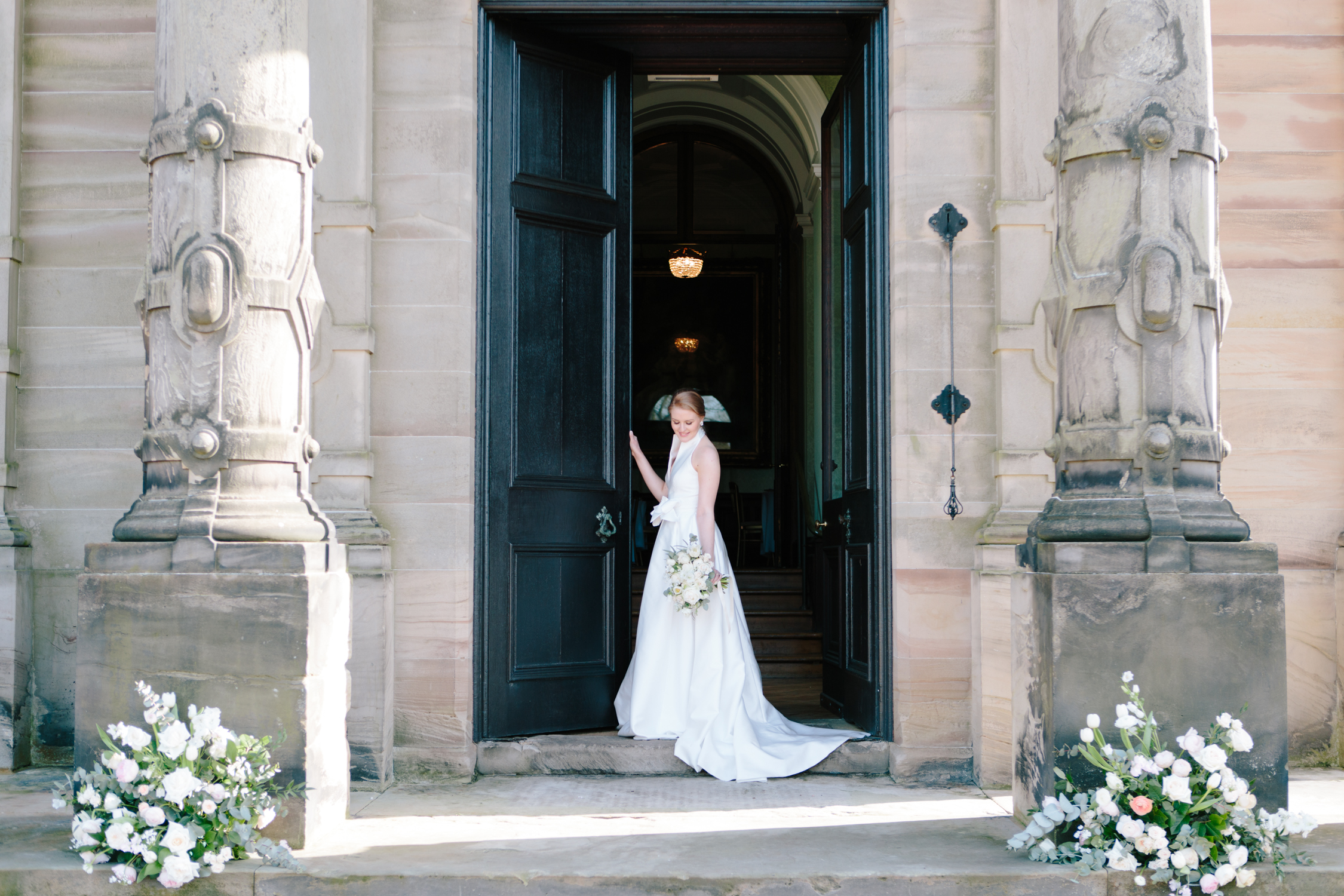 Bride at the door of Sandon Hall, wedding venue in Staffordshire for this bridal inspiration shoot featuring a Jesus Peiro wedding gown. Photography by Jade Osborne Fine art wedding photographer.