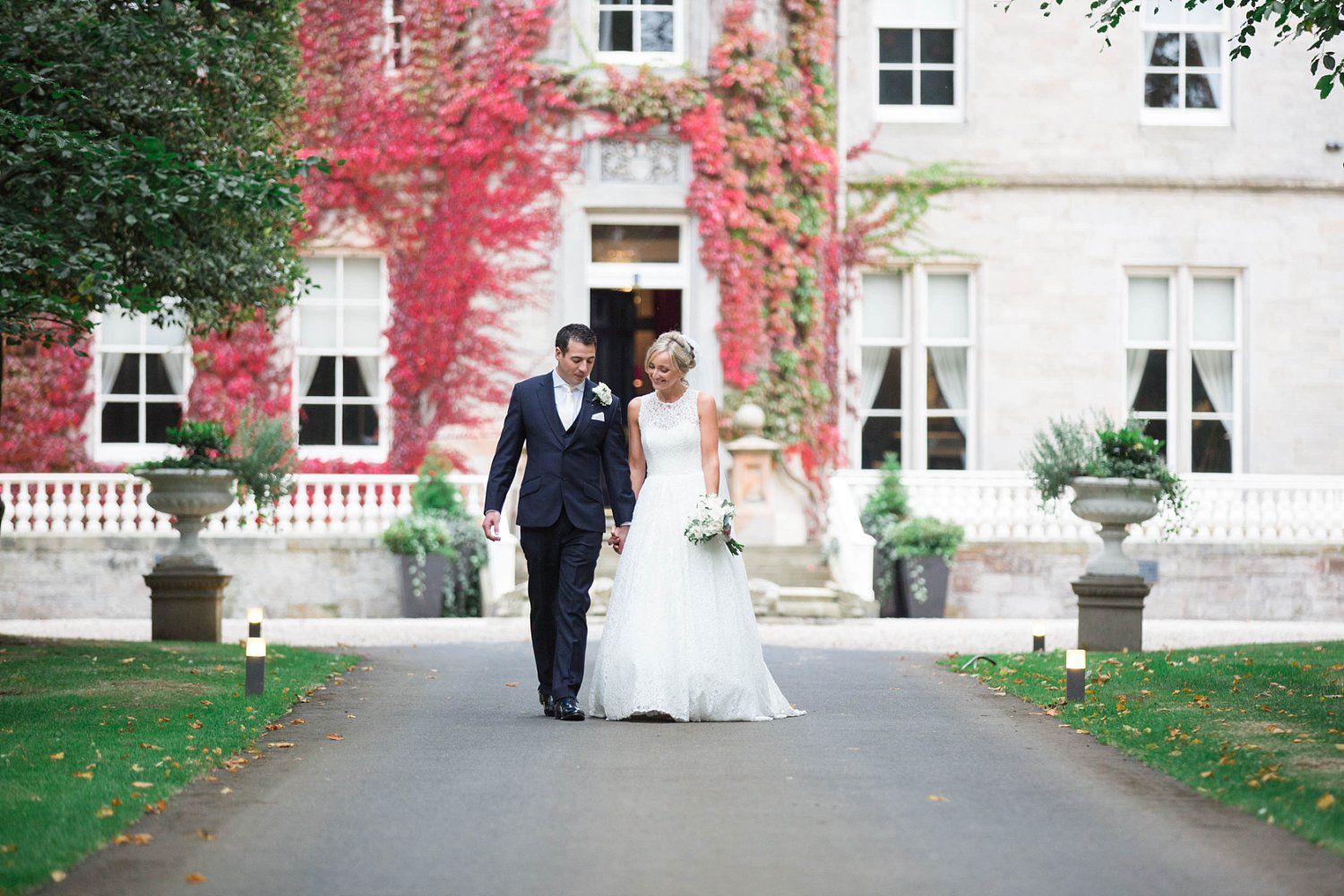 Bride in Caroline Castigliano gown at Carlowrie Castle Wedding Photo