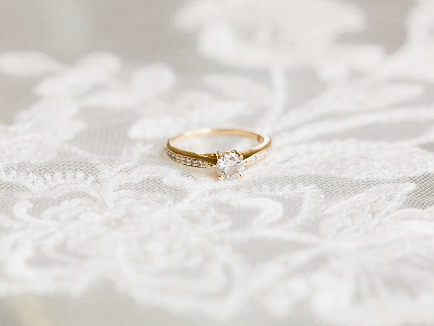 Gold and diamond engagement ring by Fine Art Wedding Photographer based in the UK